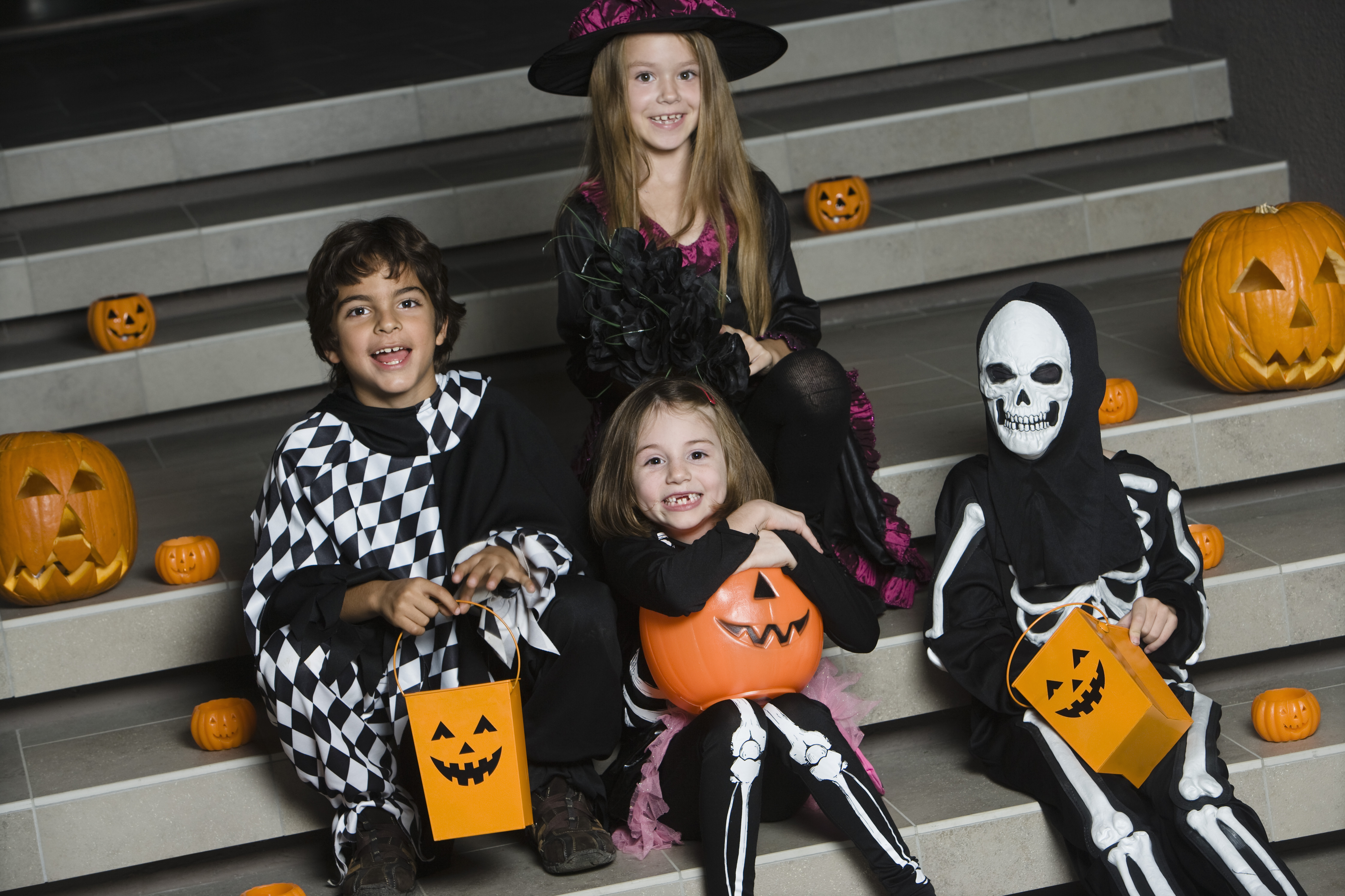 Portrait of boys and girls (7-9) wearing Halloween costumes on steps; list of Halloween events in Northern Virginia and the metro DC area