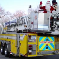 Santa visits area neighborhoods on fire trucks!