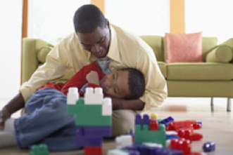 Father son playing indoor fun parenting family fun African American Black family kids children