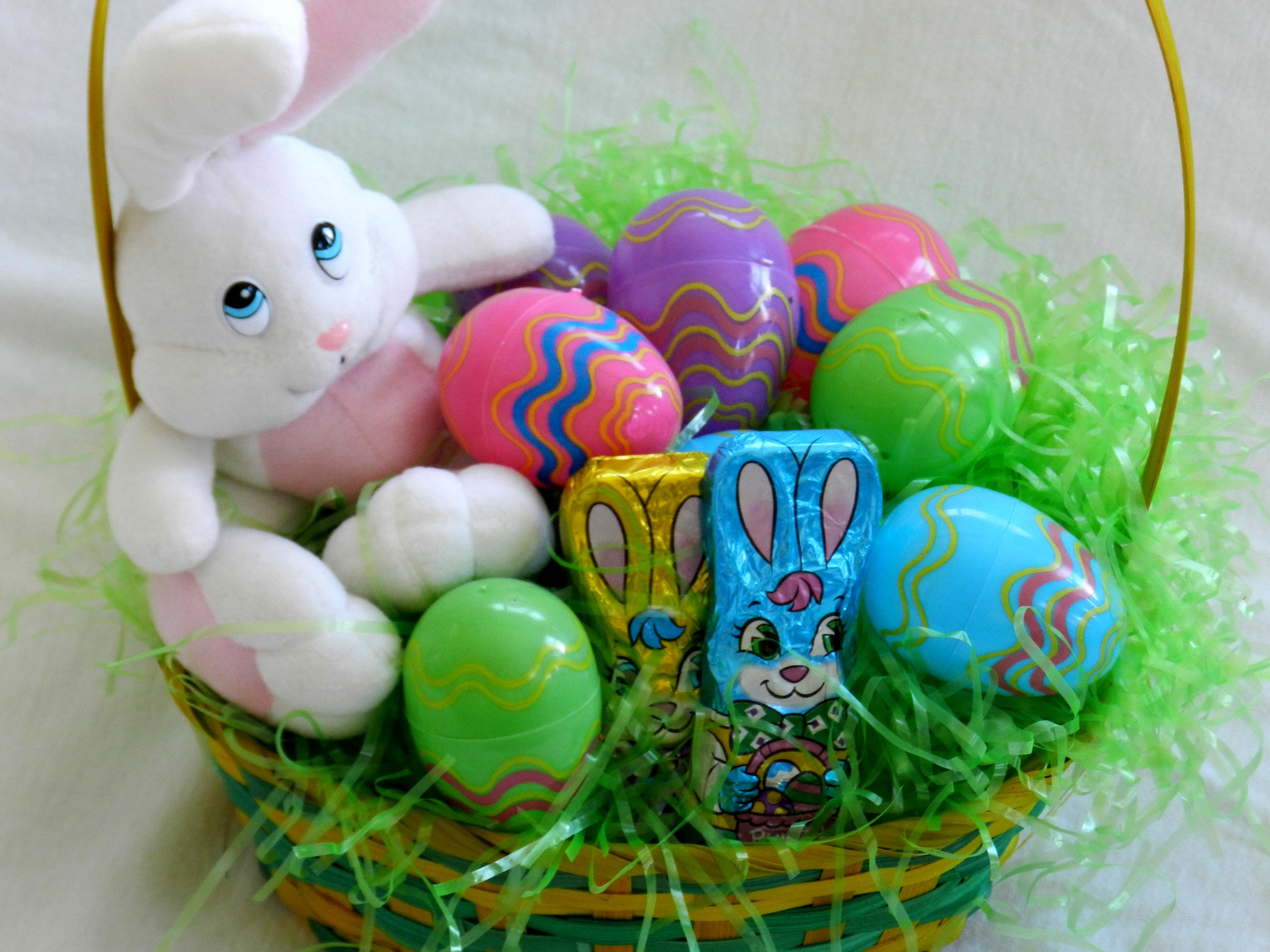 Easter basket with bunny and chocolates and plastic eggs