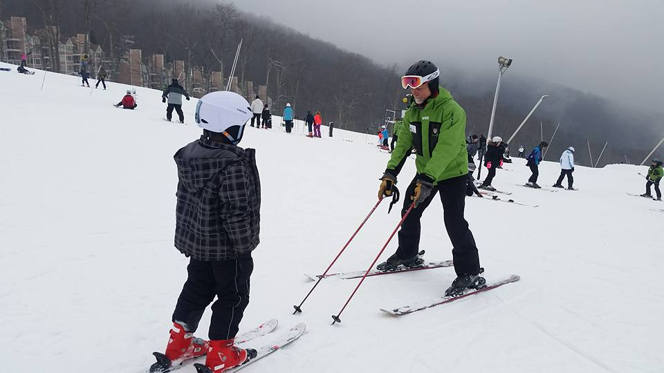 A Wintergreen Resort ski instructor with a young child