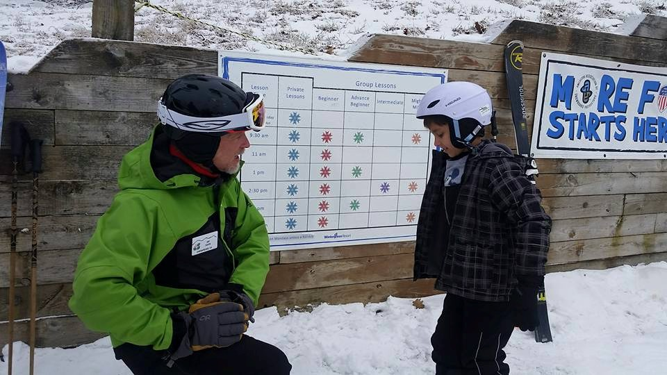 Ski instructor talking to a young child at Wintergreen Resort