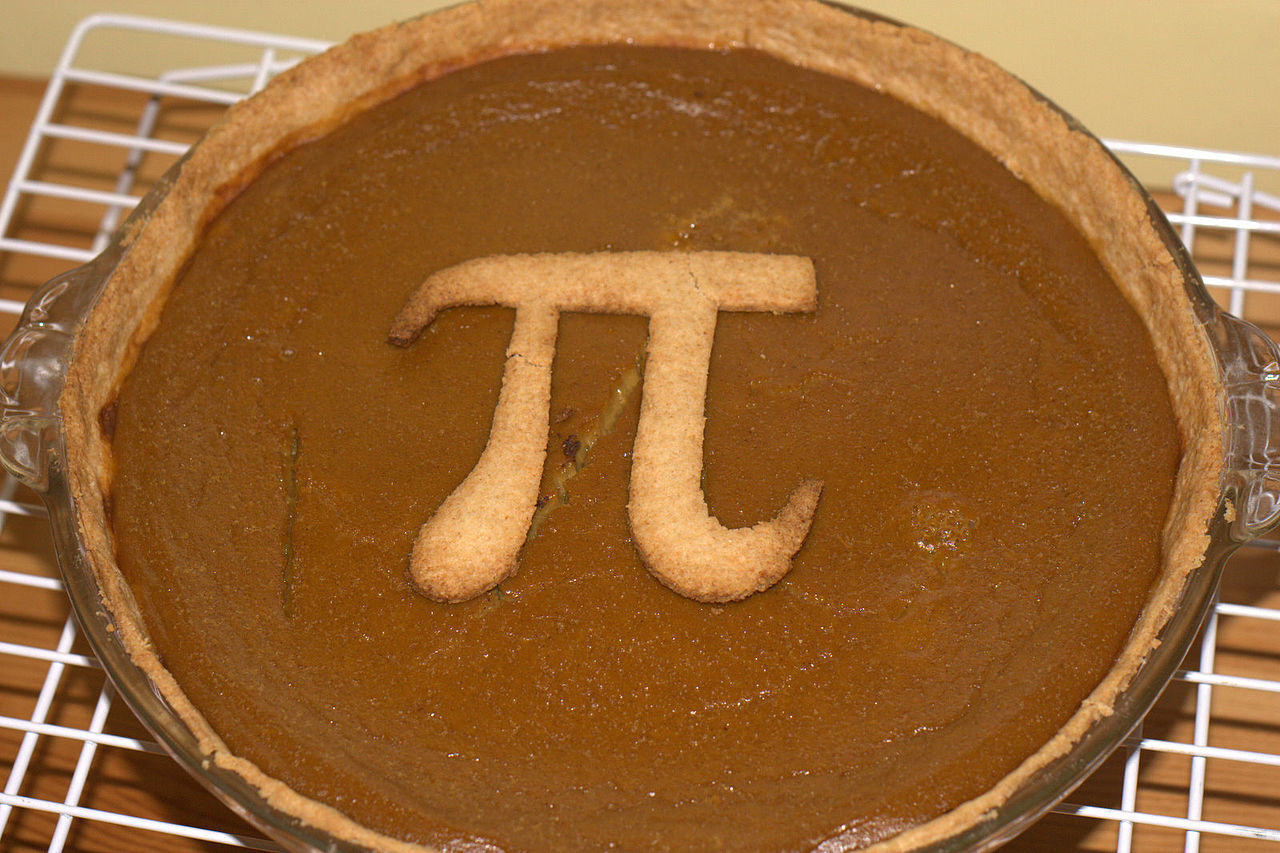 A pumpkin pie with a Pi symbol crust decoration