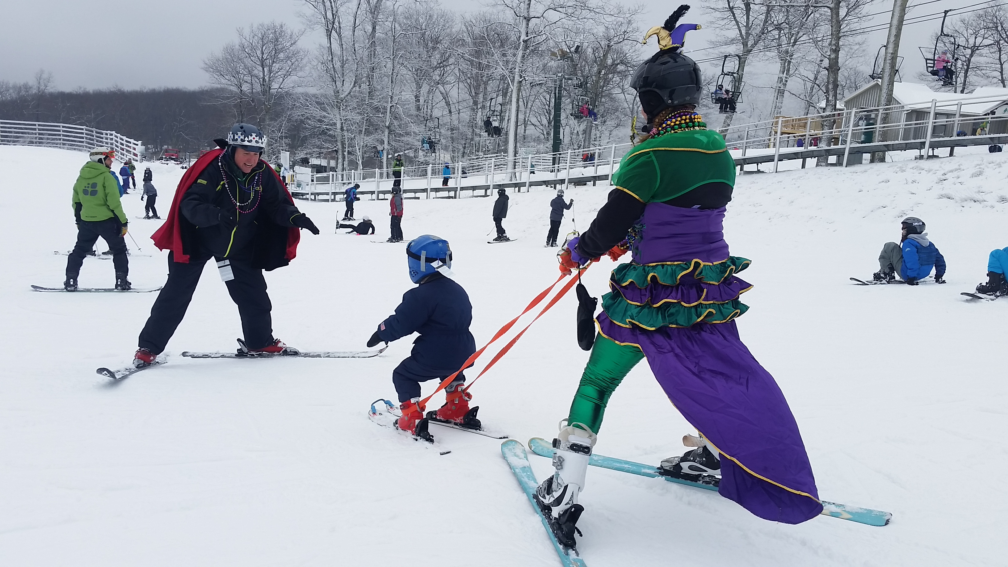 Wintergreen Adaptive Sports teachers help a young child learn to ski at Wintergreen Resort