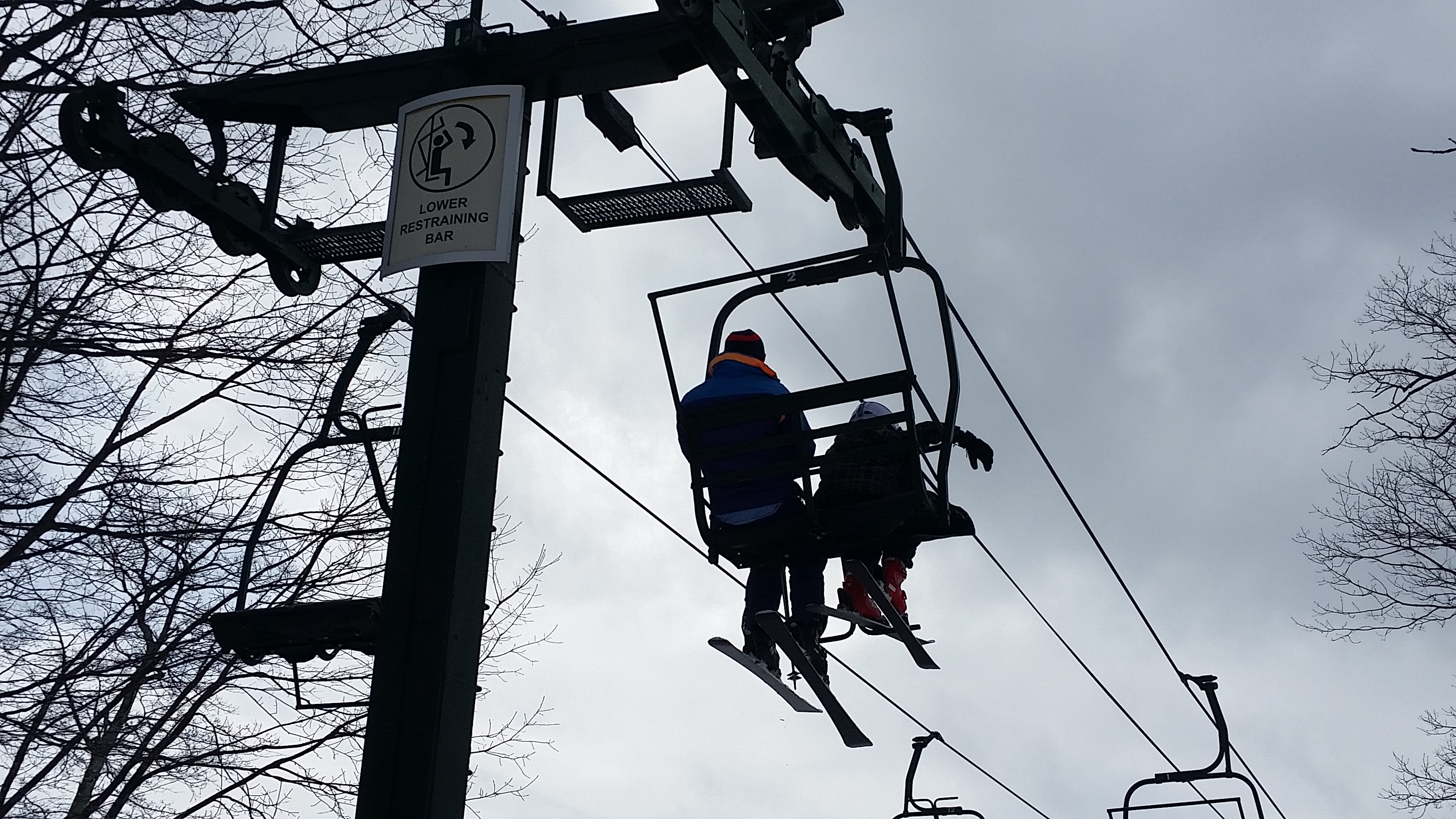 Adult and child on ski lift at Wintergreen Resort in Virginia