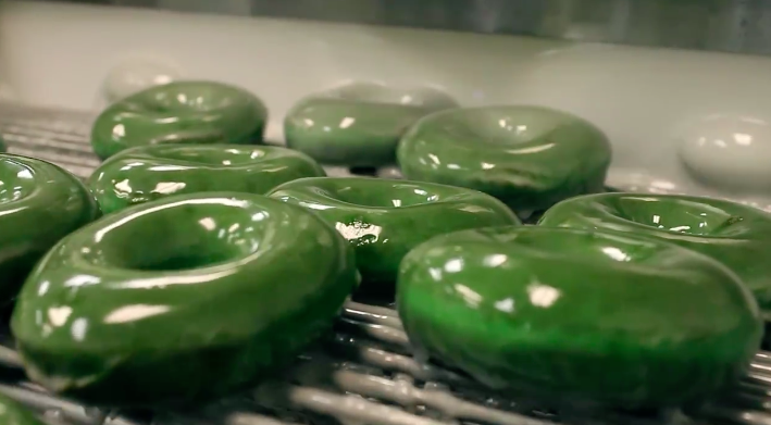Green glazed donuts being made fresh a Krispy Kreme for St. Patrick's Day