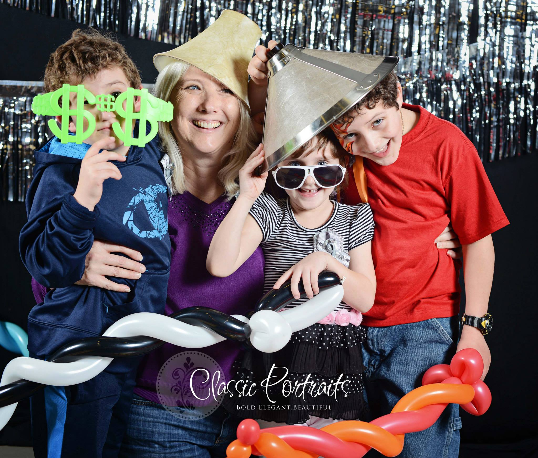 A family at a fun photo booth at Silver Sparkles