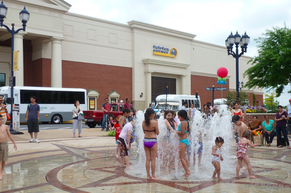 Kids splashing in the Fairfax Corner Fountain