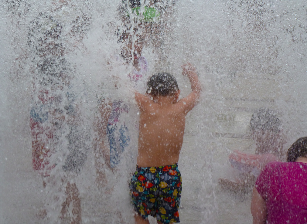 Kids splashing in the Fairfax Corner Fountain