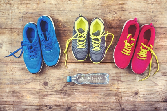 three pairs of sneakers or running shoes