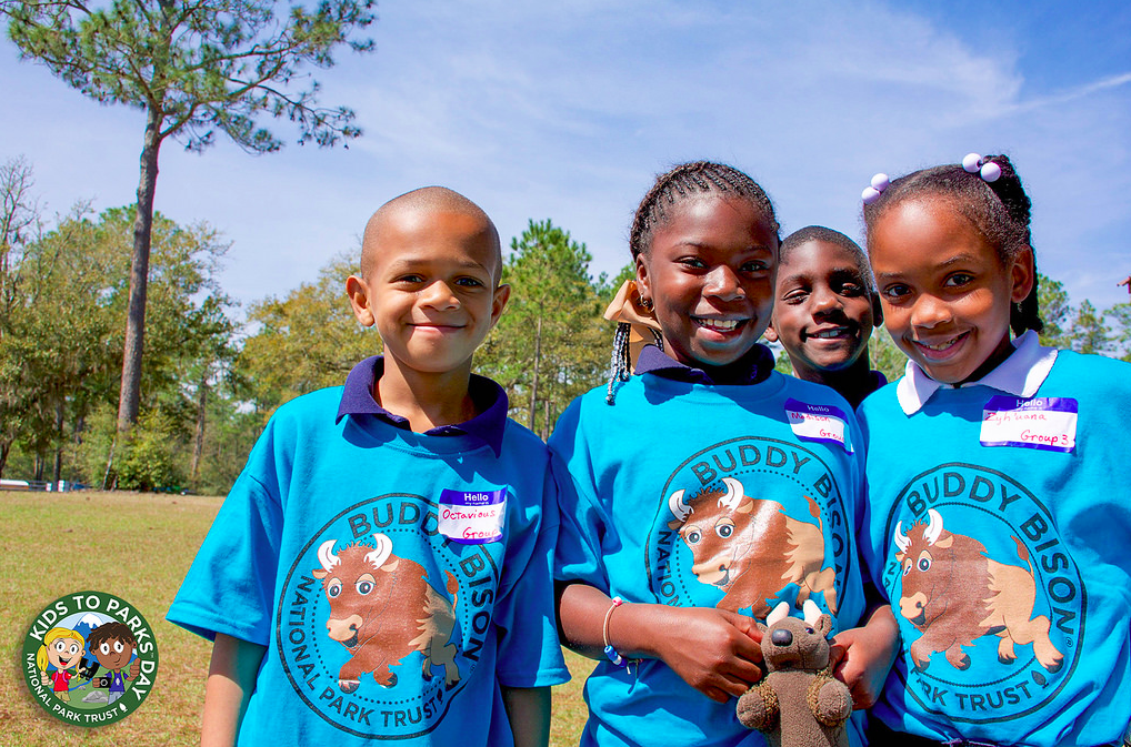 Photo of young African American children enjoying a park on Kids to Parks Day