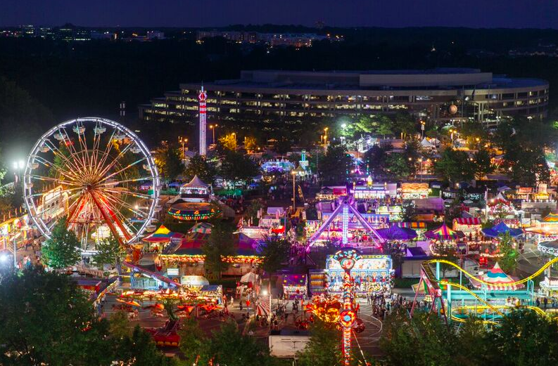 Celebrate Fairfax festival illuminated at night by carnival rides