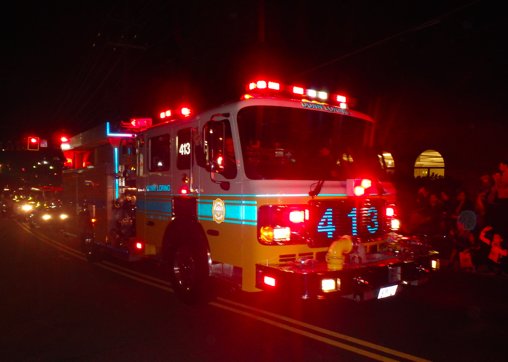 fire truck with lights on at the vienna halloween parade in virginia - Vienna Va Halloween Parade