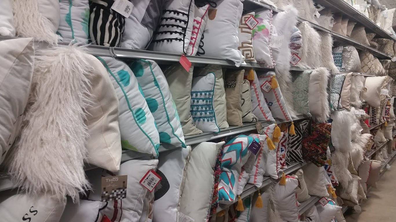 A comfy cushion can be a gift in itself or a fun way to present a gift card