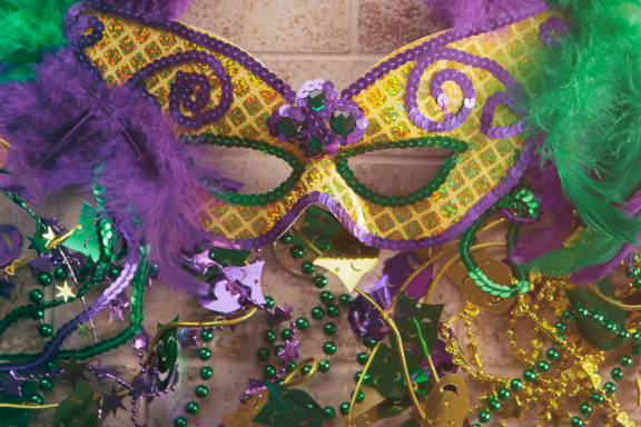 Mardi Gras carnival mask and beads