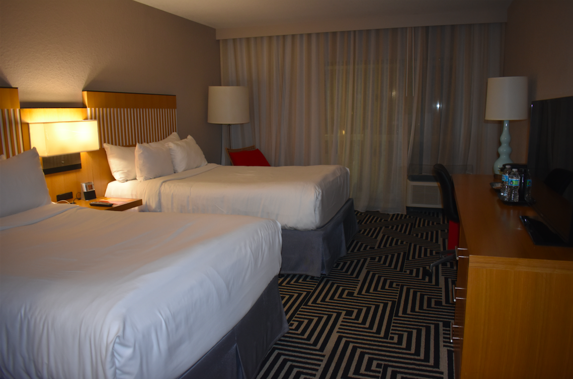 Inside of a Wyndham Orlando Resort International drive room with two beds