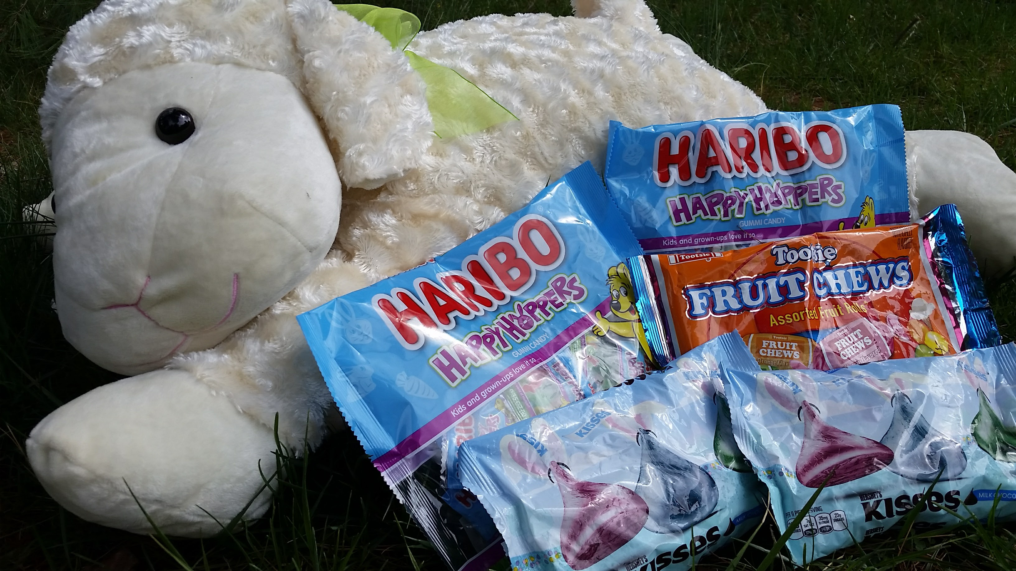 Large plush lamb with Easter candy bags