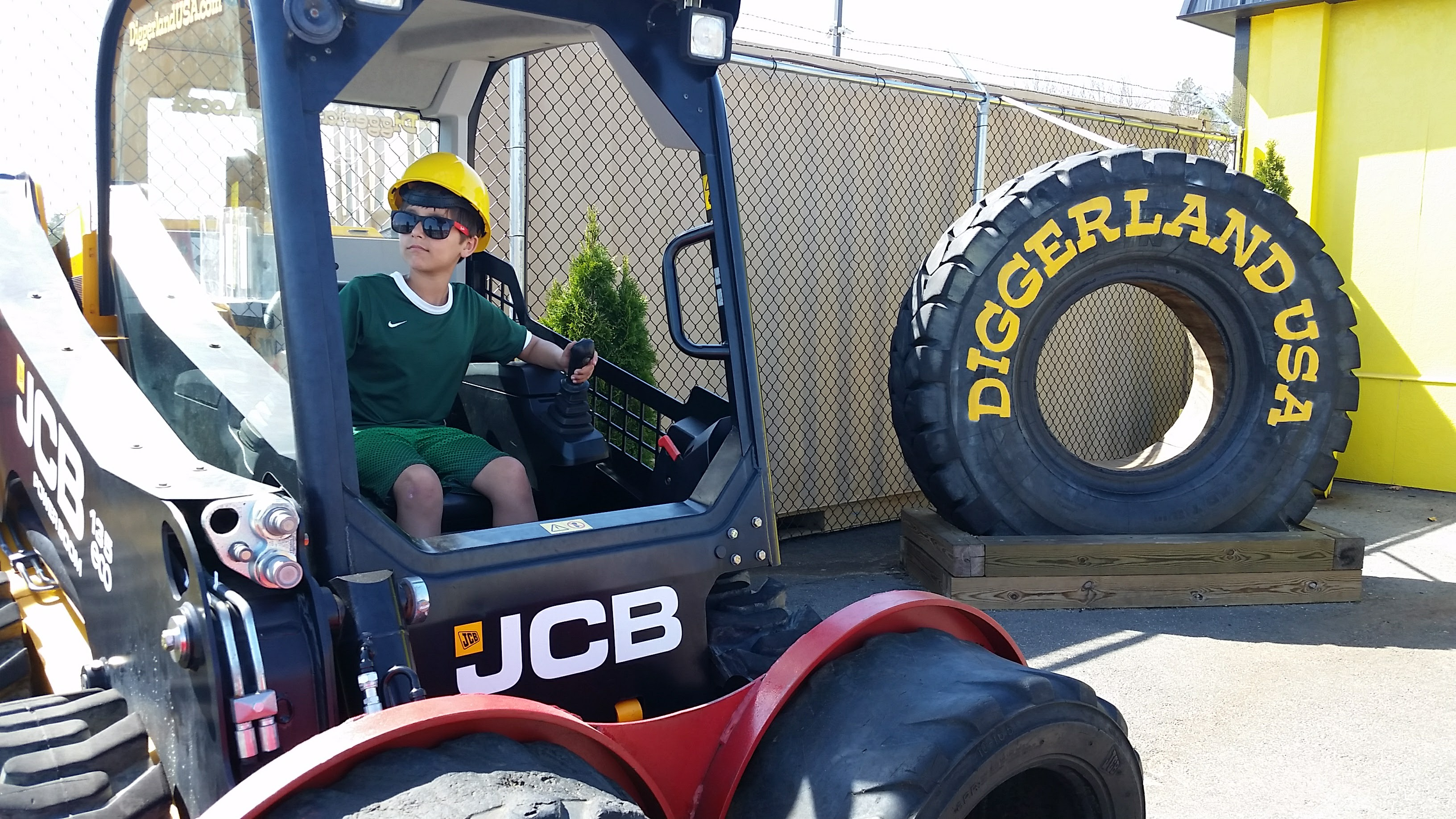 Boy sitting on a tractor at Diggerland USA