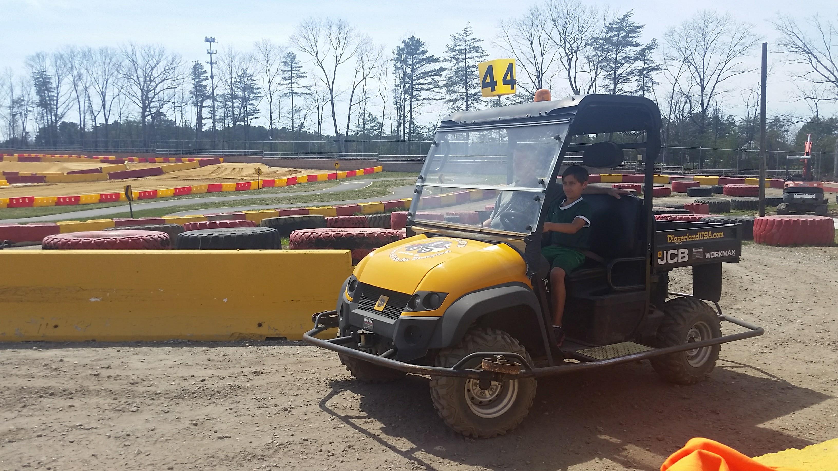 Kid driving a truck at Diggerland USA