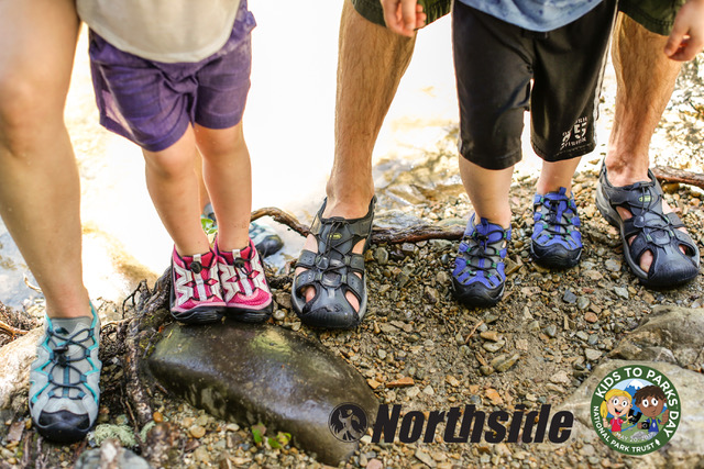 Family wearing outdoor shoes for Kids to Parks Day