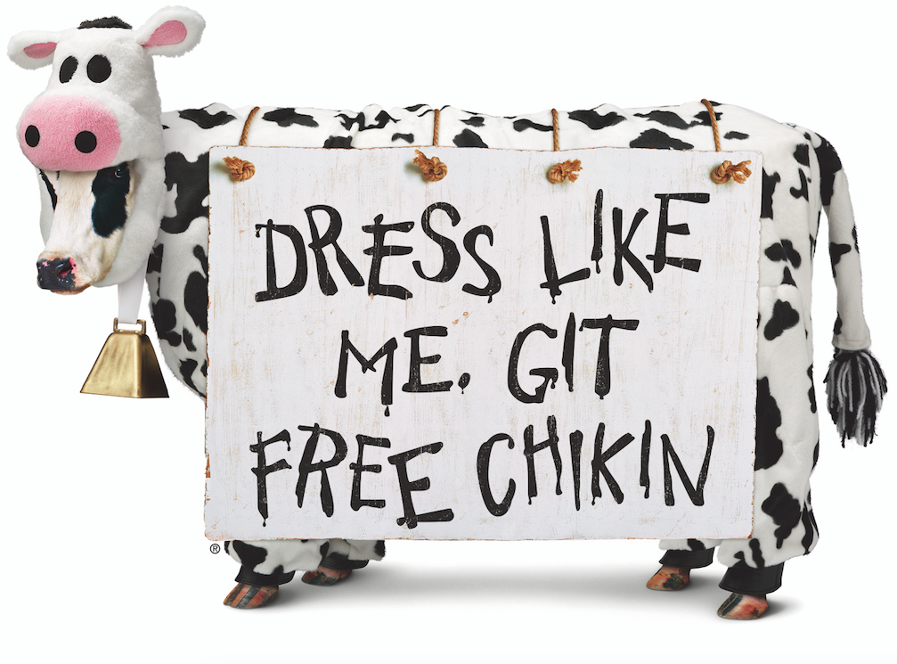 Chick-fil-A cow with sign for Cow Appreciation Day