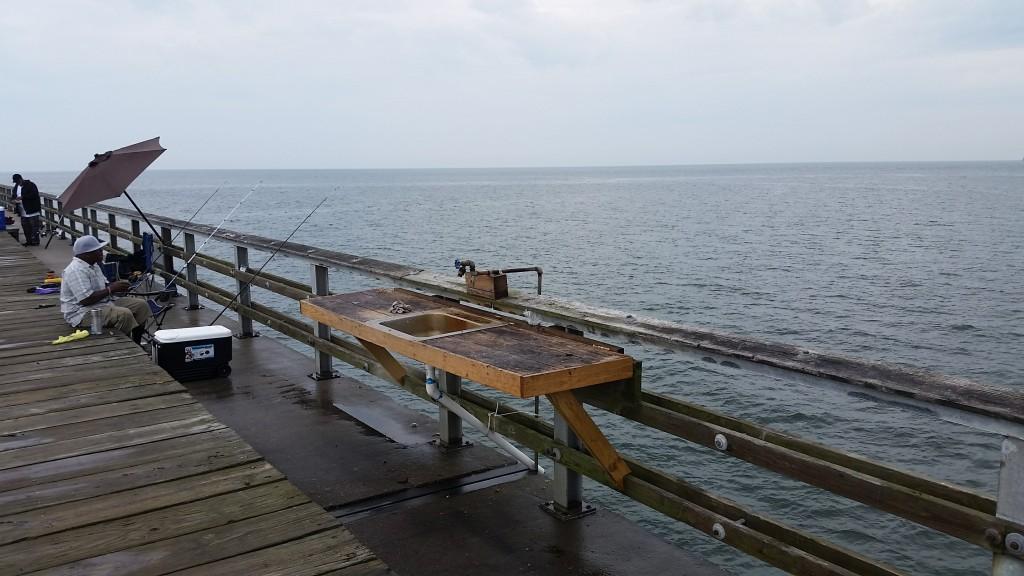Chesapeake Bay-Bridge Tunnel restaurant by the fishing pier; man fishing