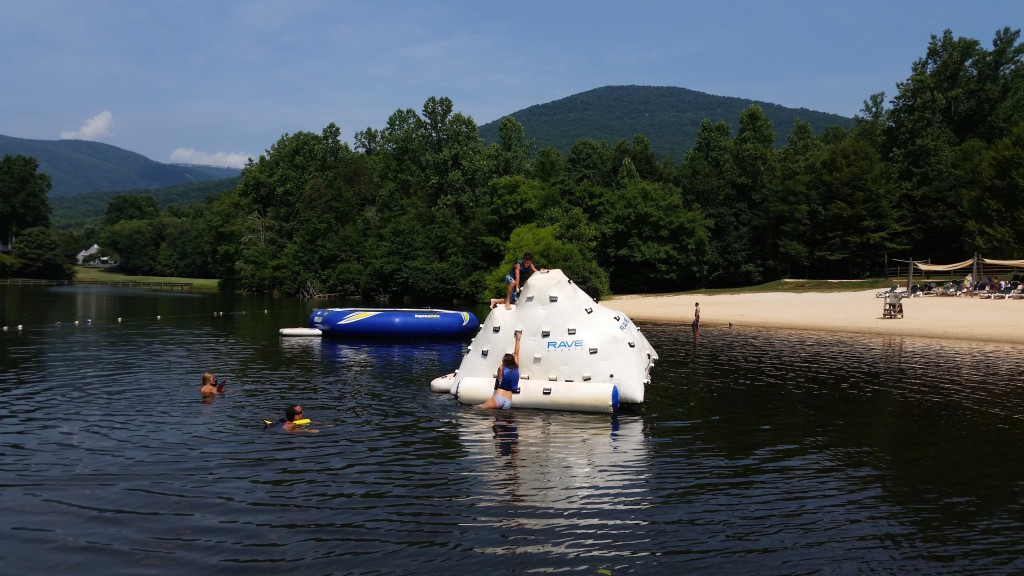 Lake Monocan trampoline and inflatable climbing tower at Lake Monocan at Wintergreen Resort