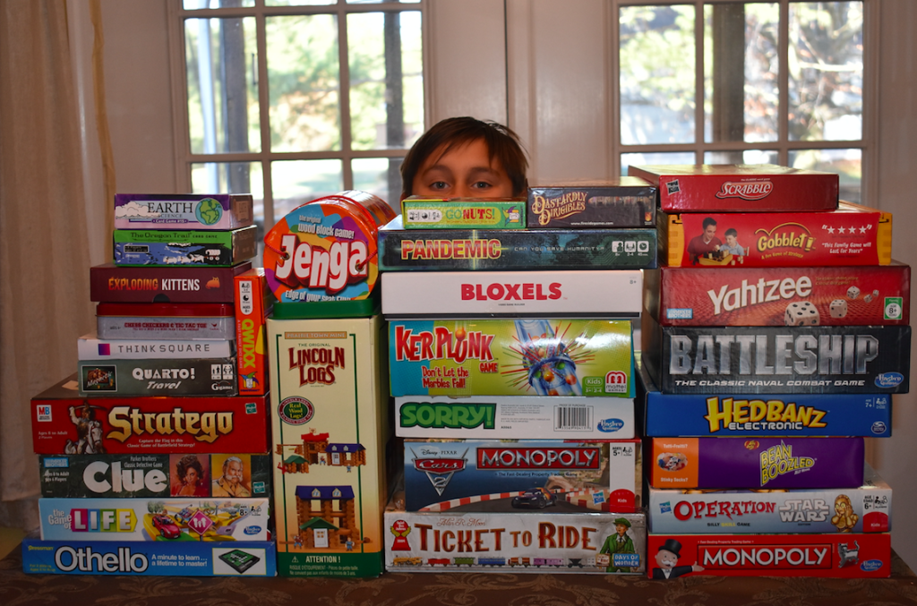 The Genius of Play: boy surrounded by board games