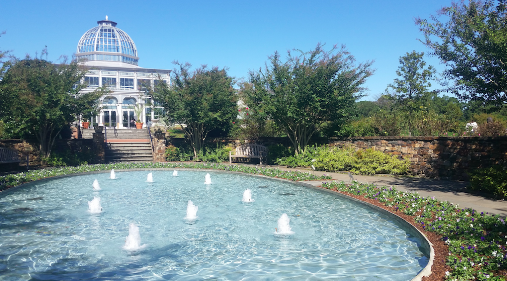 Lewis Ginter Botanical Garden in Richmond, VA, exterior of greenhouse with water fountain in front