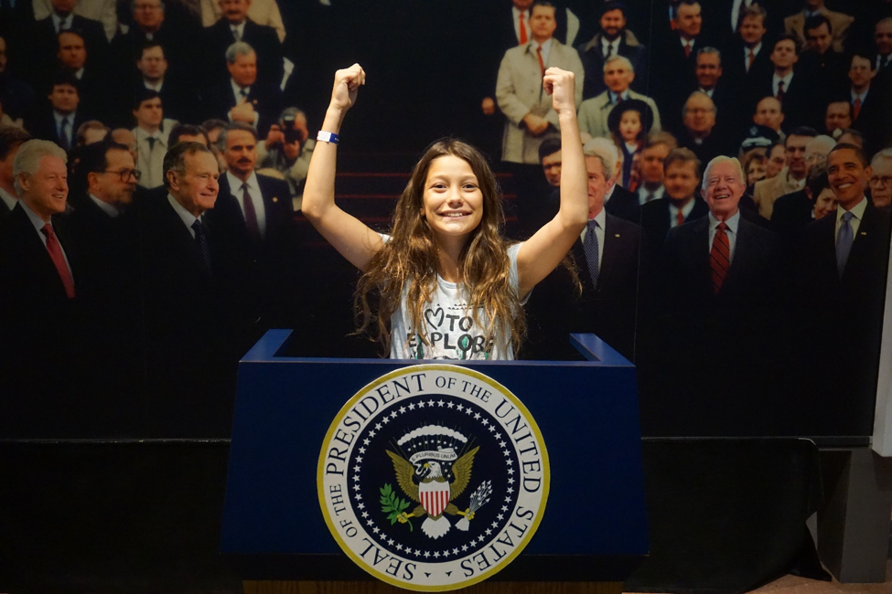 A girl at the mock inaugural podium at the Constitution Center in Philadelphia.