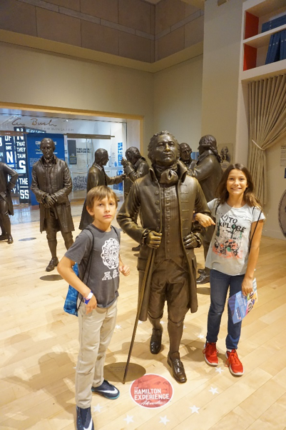 Alexander Hamilton statue and visiting kids at the Constitution Center in Philadelphia