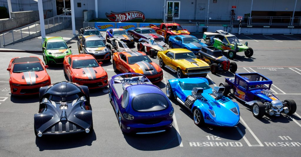 Life-size Hot Wheels cars in a parking lot as part of the Legends tour