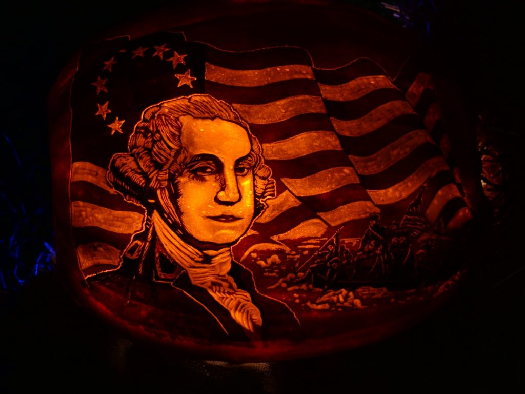 The Glow jack-o-lantern George Washington and flag carved pumpkin