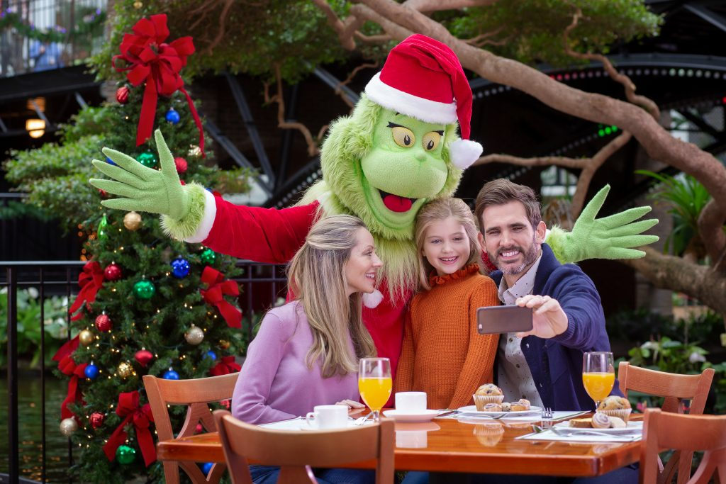 Family dining with the Grinch at the breakfast buffet at Gaylord National ICE Christmas on the Potomac