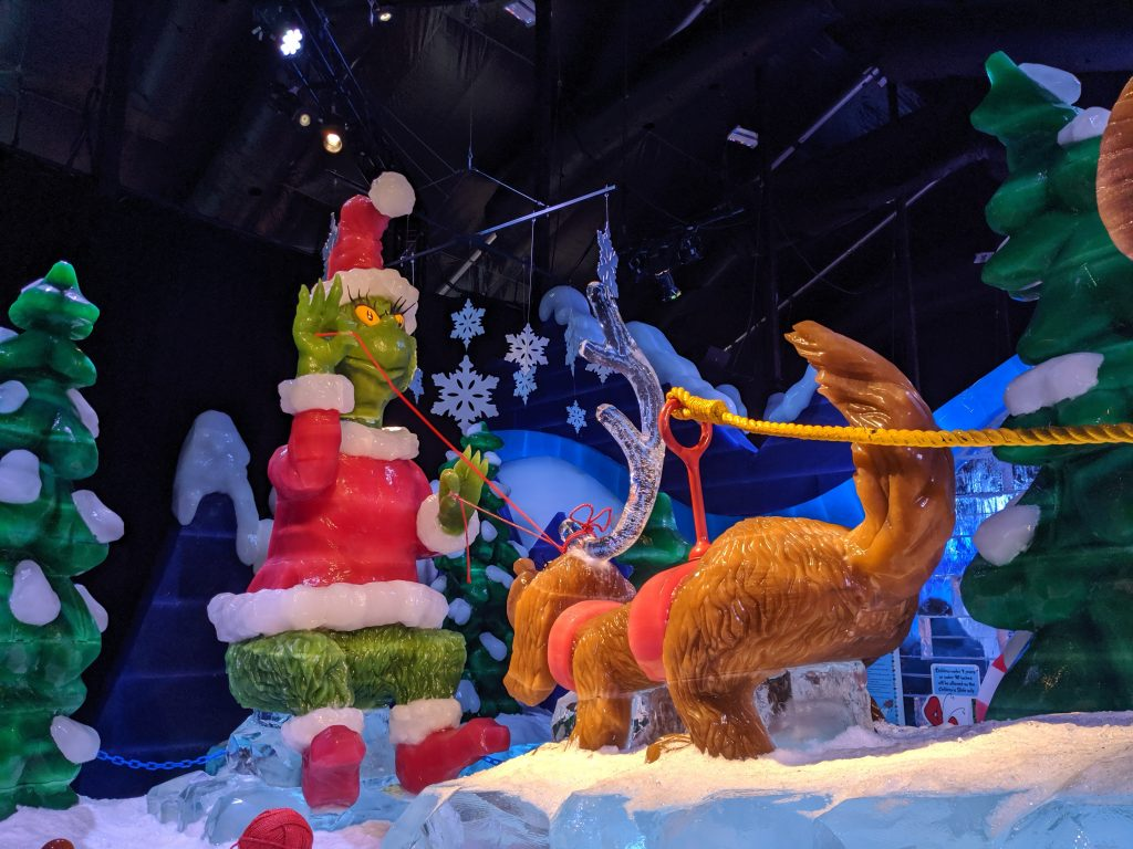 Grinch and Max pulling a sleigh at Gaylord National ICE Christmas on the Potomac