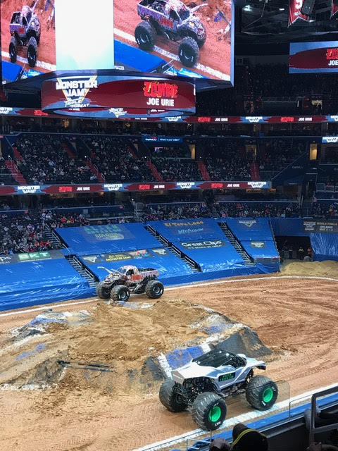 Two trucks at the Monster Jam monster truck competition