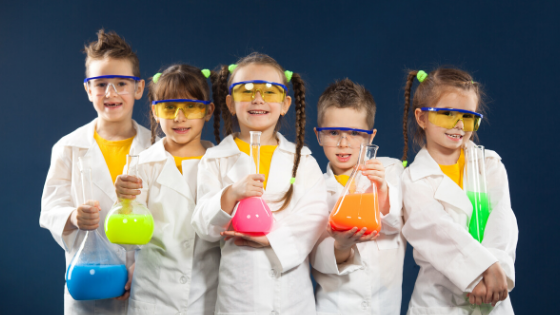 USA Science & Engineering Festival -- five kids, boys and girls, dressed like scientist in lab coats, holding colorful beakers. Image to represent the STEM activities at the upcoming science and engineering festival in Washington, DC, April 2020.